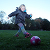Tessa Manderson, 6, of Bevelry kicks a soccer ball around at the Cross Street soccer fields on Tuesday evening. David Le/Staff Photo