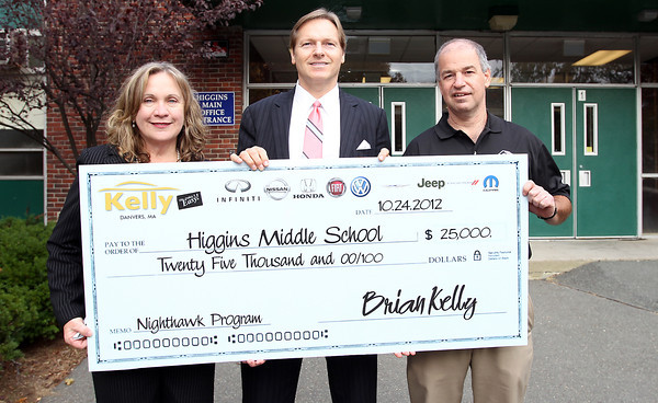 From left, Joanne Scott, Executive Director of the Boys and Girls Club of Greater Salem, Brian Kelly, of Kelly Automotive, and Doug Bollen, Operations Director of the Boys and Girls Club of Salem, stand outside Higgins Middle School in Peabody on Wednesday afternoon. Kelly donated $25,000 to the Peabody Higgins Middle School Nighthawk Program to get the Boys and Girls Club afterschool program back up and running. David Le/Staff Photo