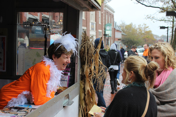Susan Larsen gives advice from the information booth Sunday, Oct. 28, on Washington Street at Essex Street in Salem.<br /> Alan Burke/Staff photo