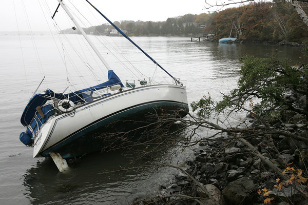 Marblehead:<br /> One of a few sailboats which got loose during the storm in Salem Harbor and was beached in Marblehead. Another is in the background.<br /> Photo by Ken Yuszkus/The Salem News, Tuesday, October 30, 2012