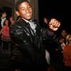 Alex Diaz, 13, of Salem, dances near the gazebo in Salem Common following the annual Halloween Parade. David Le/Staff Photo