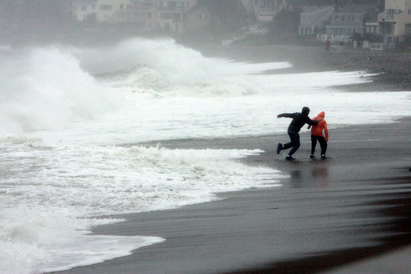 Marblehead:<br /> Charlie Ayer, left, and Cam Knight, both of Marblehead, run from the waves at Devereux Beach during high tide.<br /> Photo by Ken Yuszkus/The Salem News, Monday, October 29, 2012.