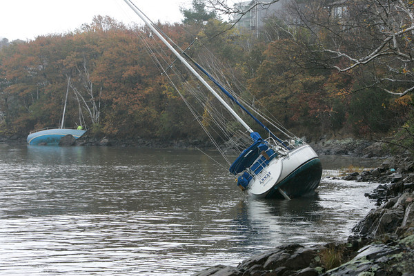Marblehead:<br /> Two of three sailboats which got loose during the storm in Salem Harbor and was beached in Marblehead.<br /> Photo by Ken Yuszkus/The Salem News, Tuesday, October 30, 2012