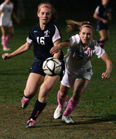 Danvers:<br /> Swampscott's Shauna King, left, and Danvers' Chrissy Gikas go after the ball during the Swampscott at Danvers girls soccer game.<br /> Photo by Ken Yuszkus/The Salem News, Monday, October 22, 2012.