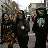 From left, Cindy Costa, Courtney Costa, and Ken Costa, all from New Bedford, stroll the pedestrian mall during Halloween in Salem.<br /> Photo by Ken Yuszkus.