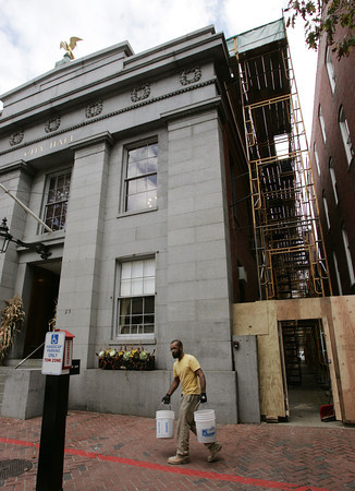 Salem:<br /> Mason Bruno Iraola walks in front of Salem City Hall where he has been working. Scaffolding on both sides of city hall has been erected for work to be done on the exterior. <br /> Photo by Ken Yuszkus/The Salem News, Wednesday, October 24, 2012.