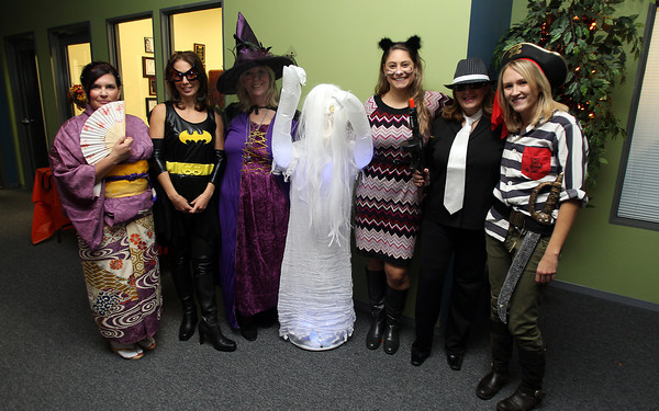 """Lauren Poussard, Ann-Marie Ciaraldi, Charlene St. Jean, Julie Adams, Fran Dichner, and Stephanie VanGeyte, at the Beverly and Peabody Chamber of Commerce's """"Spooktacular"""" event on Thursday evening. David Le/Staff Photo"""