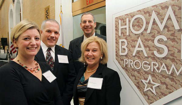 """Michelle and Mark Avery, left, and State Representative Jerry Parisella, of Beverly, and his wife Lisa, were all featured in a Home Base Program film """"Staying Strong: How Schools Build Resilience in Military Families,"""" which premiered on Monday morning in the Hall of Flags at the State House in Boston. David Le/Staff Photo"""