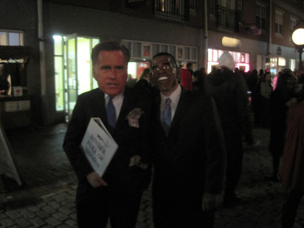 Taking a break from campaigning, Republican challenger Mitt Romney and President Barack Obama showed up last night at Salem's Halloween celebration. On the left is Matt Obey of Salem as Romney, and on the right is Tim Obert of Salem as Obama. <br /> Photo by Tom Dalton