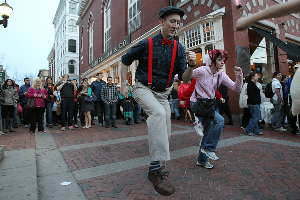 """Kevin Shell, left, and Bethany Croke, right, dance along to """"We Are Young"""" by Fun, outside Rockafellas in a flash mob dance on Saturday afternoon.  David Le/Staff Photo"""