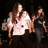 Adrianna Dykes, left, and Lia Buonfiglio, right, dance along to Michael Jackson's Thriller as they parade towards Salem Common on Thursday evening. David Le/Staff Photo