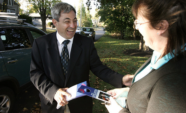 Danvers:<br /> Ted Speliotis speaks with Lisa Bucco while campaigning in the Clinton Avenue neighborhood.<br /> Photo by Ken Yuszkus/The Salem News, Monday, October 22, 2012.