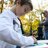 AJ Altieri, 7, colors a Halloween decoration on Friday afternoon.  David Le/Staff Photo