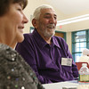 Anthony Koutzoukis, left, and his wife Esther, left, from the Peabody High School Class of 1942, reminisce with classmates on Friday afternoon at the Torigian Community Life Center for their 70th Class Reunion. David Le/Staff Photo