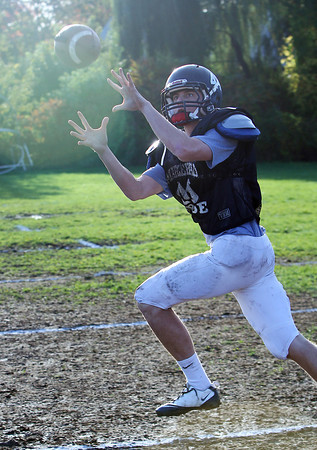 Marblehead's Brooks Tyrrell looks in a pass during practice on Wednesday afternoon. Tyrrell and the undefeated Magicians will host Gloucester on Friday night at Piper Field. David Le/Staff Photo