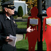 Beverly:<br /> Sgt. Phil McCarthy, who is the supervisor of the domestic violence unit of the Beverly Police Department, speaks during the Silent Witness Display ceremony on the Beverly Common. The display features free-standing, life-size wooden figures painted in red, each one bearing the name of a Massachusetts victim who once lived, worked, had neighbors, friends, family, children – whose life ended violently at the hands of an intimate partner or acquaintance. An extra figure is added to represent those uncounted victims whose murders went unsolved or were erroneously ruled accidental. <br /> Photo by Ken Yuszkus/The Salem News, Monday, October 22, 2012.