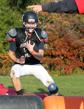 Marblehead running back Zac Cuzner makes a cut during a drill at practice on Wednesday afternoon. Cuzner and the Magicians are gearing up for Gloucester on Friday evening. David Le/Staff Photo