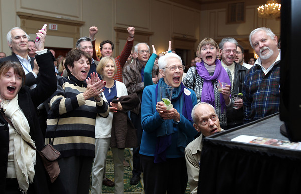 SALEM: A crowd of Tierney supporters surrounding a TV at the Hawthorne Hotel on election night cheer after hearing that Democrat Elizabeth Warren had defeated Republican Scott Brown for U.S. Senate. <br /> David Le/staff photo