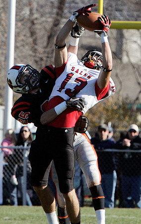 Beverly:<br /> Salem's Ben Kapnis catches the pass as Beverly's Joey Kozlowski goes after it also during the Salem at Beverly Thanksgiving football game held at Hurd Stadium.<br /> Photo by Ken Yuszkus/The Salem News, Thursday, November 22, 2012.