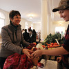 Kathleen Ternes, left, of Salem, buys apples from Kate McGoldrick, right, of Clark Farm in Danvers, at the Salem Winter Farmer's Market on Thursday afternoon in the Old Town Hall. David Le/Staff Photo