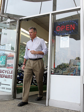 BEVERLY — Sen. Scott Brown leaves Browns of Beverly Bicycles on Cabot Street after a visit on Friday, July 27. David Le/Staff photo
