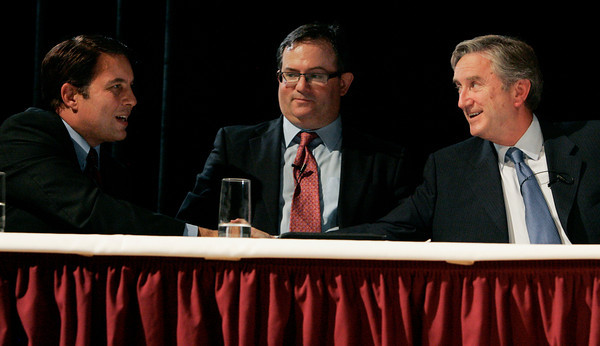 DANVERS — Richard Tisei, left, shakes hands with John Tierney, right, with Daniel Fishman in the middle at the conclusion of the congressional debate at Danvers High School Oct. 10.<br /> Ken Yuszkus/Staff photo