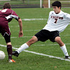 Ipswich:<br /> Ipswich's Zachary Eliopoulos, right, reaches to kick the ball as Whittier's Steven Stefanelli scoops it away during the Whittier at Ipswich boys soccer Division 3 North state tournament game.<br /> Photo by Ken Yuszkus/The Salem News, Friday, November 2, 2012.