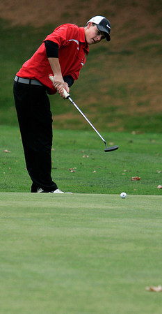Beverly:<br /> Masconomet's Zack Staub watches his ball roll toward the 18th hole, but it swung to one side during the Division 2 boys state golf final at Beverly Golf & Tennis.<br /> Photo by Ken Yuszkus/The Salem News, Monday, November 5, 2012.