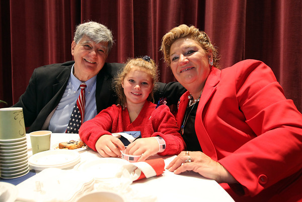 Paul and Stephanie Pappagianopoulos, of Peabody, with their granddaughter Penelope Spack, 7, at the first annual Veterans Breakfast held at City Hall, hosted by Peabody Mayor Ted Bettancourt. David Le/Staff Photo