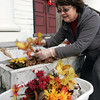 Beverly:<br /> Nanette Maden, church volunteer, removes the autumn flower display to make room for the holiday display on the front steps of the Dane Street Congrgational Church.<br /> Photo by Ken Yuszkus/The Salem News, Monday, November 26, 2012.