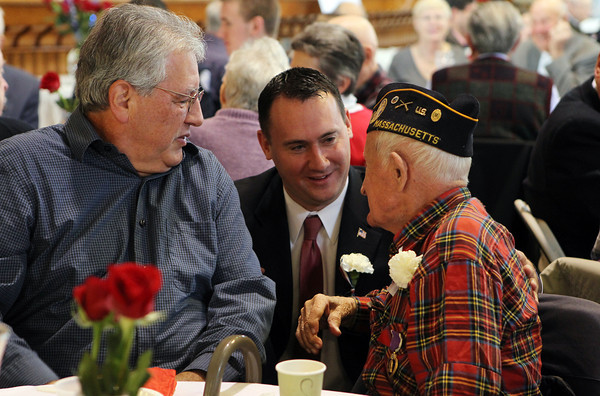 """Peabody Mayor Ted Bettancourt, center, talks with Theodore """"Ted"""" Lazarakis, right, and Nick Lazarkis, left, at the first annual Veterans Breakfast in the Wiggin Auditorium at City Hall on Sunday morning. David Le/Staff Photo"""