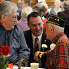 "Peabody Mayor Ted Bettancourt, center, talks with Theodore ""Ted"" Lazarakis, right, and Nick Lazarkis, left, at the first annual Veterans Breakfast in the Wiggin Auditorium at City Hall on Sunday morning. David Le/Staff Photo"