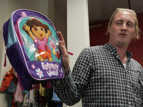 """Salem:<br /> Victor Gabrielii Augustsson, consumer advocate for MISSPIRG, speaks about the toxic chemicals found in the Dora Explorer backpack during MISSPIRG's annual """"Trouble in Toyland"""" press conference on unsafe toys on store shelves.<br /> Photo by Ken Yuszkus/The Salem News, Tuesday, November 20, 2012."""