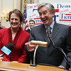 Re-elected US Congressman John Tierney and his wife Patrice thank a large crowd gathered in the Ballroom at the Hawthorne Hotel in Salem early Wednesday morning after narrowly beating out challenger Richard Tisei. David Le/Staff Photo