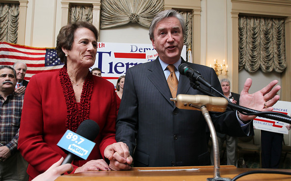 US Congressman John Tierney holds his wife Patrice's hand as he thanks a room packed with supporters after narrowly defeating challenger Richard Tisei at the Hawthorne Hotel early Wednesday morning. David Le/Staff Photo