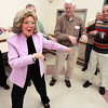 Peabody:<br /> Barbara Therrien teaches the men how to hula dance for the upcoming Forever Young Chorus music program. <br /> Photo by Ken Yuszkus/The Salem News, Thursday, November 8, 2012.