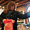 Sue Mullins, of Stoneham, browses through goods at Avalanche on Front St. in Salem on Friday afternoon. David Le/Staff Photo
