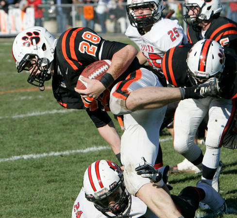 Beverly:<br /> Beverly's Kenny Pierce goes through the air after hit by Salem's Anferne Jimenez during the Salem at Beverly Thanksgiving football game held at Hurd Stadium.<br /> Photo by Ken Yuszkus/The Salem News, Thursday, November 22, 2012.
