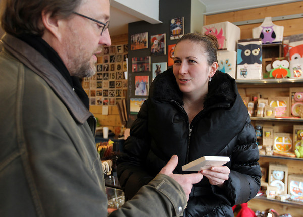 Nick Capasso, of Acton, left, and Victoria Glazomitsky, right, of Jamaica Plain, shop at Roost, on Front St. in Salem on Friday afternoon. David Le/Staff Photo