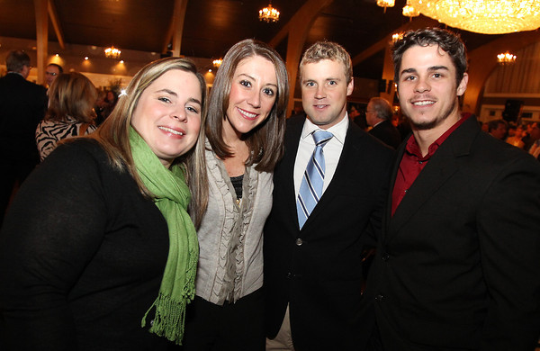 From left, Lauren Hubacheck, Jennifer Bertolon, Michael Card, and Brody Preston, at the North Shore Chamber of Commerce Annual Dinner at the Danversport Yacht Club on Wednesday evening. David Le/Staff Photo