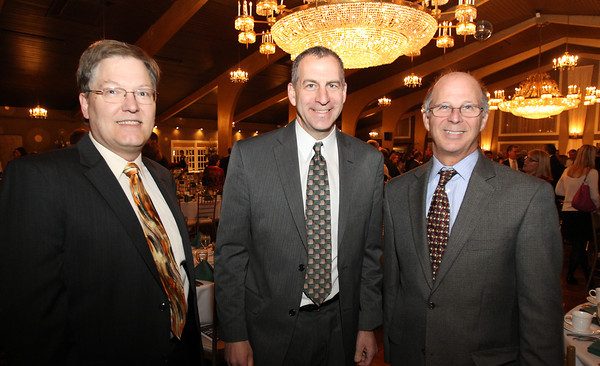 From left, Bruce Dyas, of National Grid, State Representative Jerry Parisella of Beverly, and Joe Newman, also of National Grid, at the North Shore Chamber of Commerce Annual Dinner at the Danversport Yacht Club on Wednesday evening. David Le/Staff Photo
