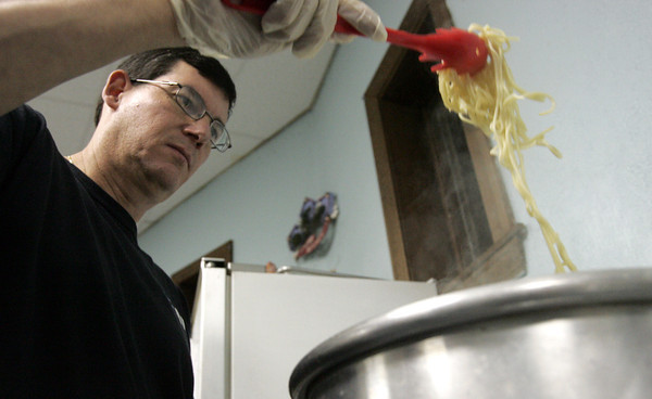Danvers:<br /> Chuck Orphanos removes cooked spaghetti from a boiling pot of water during the spaghetti supper at All Saints Episcopal Church. It is a fundraiser to help Ma Duke's with its Thanksgiving dinner for the needy.<br /> Photo by Ken Yuszkus/The Salem News, Friday, November 16, 2012.