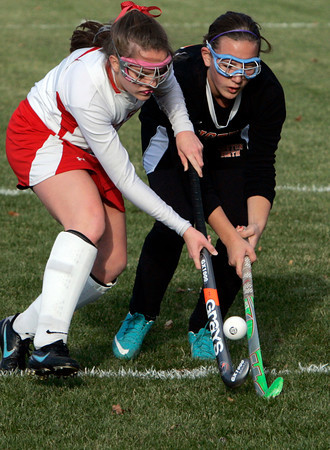 Topsfield:<br /> Masconomet's Maggie Moffet , left, and a Newton North player pop the ball in the air as they try to gain control during the Newton North at Masconomet field hockey state tournament game.<br /> Photo by Ken Yuszkus/The Salem News, Monday, November 5, 2012.