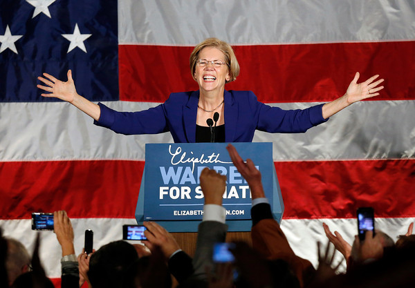Democrat Elizabeth Warren takes the stage after defeating incumbent GOP Sen. Scott Brown in the Massachusetts Senate race, during an election night rally at the Fairmont Copley Plaza hotel in Boston, Tuesday, Nov. 6, 2012. (AP Photo/Michael Dwyer)