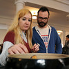 Sasha Ernest, left, and Justin Young, right, tourists from Philadelphia, PA, browse through goods at the Salem Indoor Farmer's Market on Thursday afternoon. David Le/Staff Photo