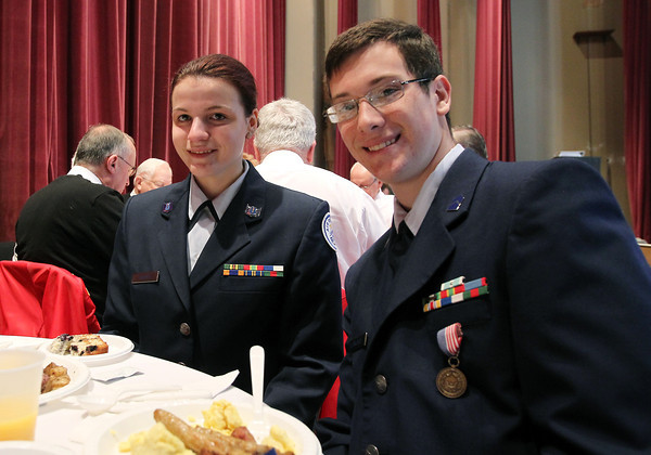 Sarah Valente, left, and Matt Leomforte, right, at the first annual Veterans Breakfast at Peabody City Hall, hosted by Mayor Ted Bettancourt on Sunday morning. David Le/Staff Photo