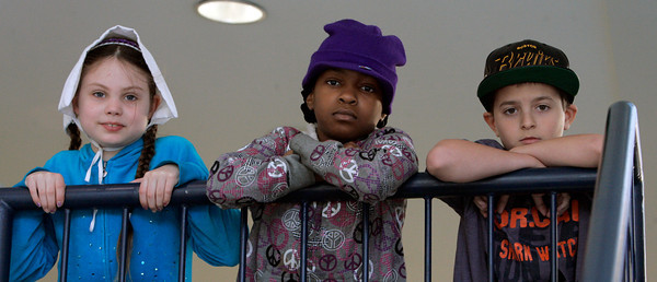 Salem:<br /> From left, 3rd grader Alexa Carr, 5th graders Keishara Johnson and Austin Bisegna wear various hats at the Bates School as part of the Hurricane Sandy fund-raiser for American Red Cross. Any child who brought in a donation for hurricane victims in NY and NJ was allowed to wear a hat all day. <br /> Photo by Ken Yuszkus/The Salem News, Friday, November 9, 2012.