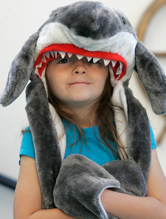 Salem:<br /> Kindergartener Emma McMahon wears a shark hat at the Bates School as part of the Hurricane Sandy fund-raiser for American Red Cross. Any child who brought in a donation for hurricane victims in NY and NJ was allowed to wear a hat all day. <br /> Photo by Ken Yuszkus/The Salem News, Friday, November 9, 2012.