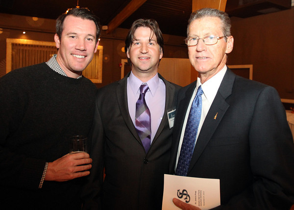 St. John's Prep 2012 Hall of Fame Inductee Scott MacDonald, center, with Matt DeAngelis, left, and John Boyle, right, at the ceremony at Danversport Yacht Club on Wednesday evening. David Le/Staff Photo