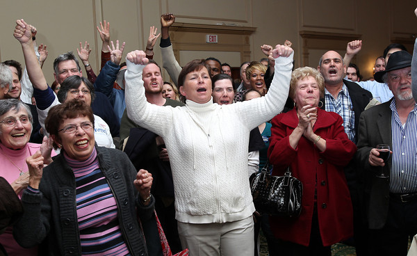 John Tierney supporters in the Ballroom at the Hawthorne Hotel in Salem erupt after the TV showed a Barack Obama victory in the Presidential Election. David Le/Staff Photo